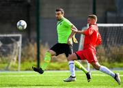6 October 2019; Ryan McManus of Connacht FA shoots to score his side's second goal, despite the pressure of Anthony O'Donnell of Munster Senior League, during the FAI Michael Ward Inter League Tournament match between Munster Senior League and Connacht FA at Kilbarrack United in Dublin. Photo by Seb Daly/Sportsfile