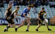 6 October 2019; Charles McGuinness of Naomh Conaill in action against Eamon Doherty, Aaron Deeney and Conor Morrison of St Eunan's during the Donegal County Senior Club Football Championship semi-final match between St Eunan's and Naomh Conaill at MacCumhaill Park in Ballybofey, Donegal. Photo by Oliver McVeigh/Sportsfile