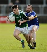 6 October 2019; Michael Carroll of Gaoth Dobhair in action against Brian McGinley of Kilcar during the Donegal County Senior Club Football Championship semi-final match between Kilcar and Gaoth Dobhair at MacCumhaill Park in Ballybofey, Donegal. Photo by Oliver McVeigh/Sportsfile