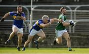 6 October 2019; Cian Mulligan of Gaoth Dobhair in action against Barry McGinley of Kilcar during the Donegal County Senior Club Football Championship semi-final match between Kilcar and Gaoth Dobhair at MacCumhaill Park in Ballybofey, Donegal. Photo by Oliver McVeigh/Sportsfile