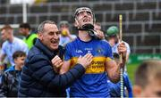 6 October 2019; Diarmuid Byrnes of Patrickswell celebrates with supporter Anthony Carmody after the Limerick County Senior Club Hurling Championship Final match between Na Piarsaigh and Patrickswell at LIT Gaelic Grounds in Limerick. Photo by Piaras Ó Mídheach/Sportsfile