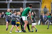 6 October 2019; Odhrán Mac Niallais of Gaoth Dobhair celebrates with young fans after the Donegal County Senior Club Football Championship semi-final match between Kilcar and Gaoth Dobhairl at MacCumhaill Park in Ballybofey, Donegal. Photo by Oliver McVeigh/Sportsfile