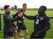 8 October 2019; Aaron Connolly is greeted by Michael Obafemi of the Republic of Ireland U21's following a Republic of Ireland training session at the FAI National Training Centre in Abbotstown, Dublin. Photo by Stephen McCarthy/Sportsfile