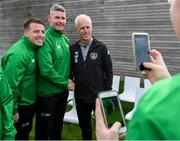 9 October 2019; Republic of Ireland manager Mick McCarthy was on hand to wish the Irish Defence Forces team a bon voyage at Abbotstown as they prepare to travel to China for the World Military Games. McCarthy joined Minister of State for Defence Paul Kehoe, FAI President Donal Conway, Brigadier General Peter O'Halloran and boxing coach Phil Sutcliffe at FAI Headquarters. The Irish Defence Forces football team, backed by the FAI, knocked Germany and Holland out of the qualifiers en route to the tournament and will be joined in Wuhon city by boxers and a shooting team. Pictured is Republic of Ireland manager Mick McCarthy with members of the Irish Defence Forces football team Scott Delaney and Anthony Jinks. Photo by Stephen McCarthy/Sportsfile