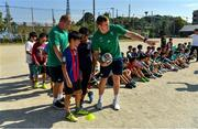 11 October 2019; Chris Farrell, right and John Ryan with students during a visit by the Ireland rugby squad to Kasuga Elementary School in Kusaga, Fukuoka, Japan. Photo by Brendan Moran/Sportsfile