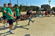 11 October 2019; Chris Farrell, Jack Carty and Garry Ringrose with students during a visit by the Ireland rugby squad to Kasuga Elementary School in Kusaga, Fukuoka, Japan. Photo by Brendan Moran/Sportsfile