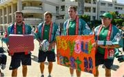 11 October 2019; Ireland players, from left, Jack Carty, Jordi Murphy, Chris Farrell and Sean Cronin with gifts that were presented to them during a visit by the squad to Kasuga Elementary School in Kusaga, Fukuoka, Japan. Photo by Brendan Moran/Sportsfile