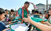 11 October 2019; Rob Kearney signs autographs for students during a visit by the Ireland rugby squad to Kasuga Elementary School in Kusaga, Fukuoka, Japan. Photo by Brendan Moran/Sportsfile