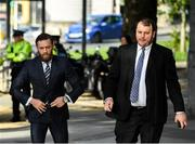 11 October 2019; Conor McGregor, left, arrives at The Criminal Courts of Justice in Dublin. Photo by Ramsey Cardy/Sportsfile