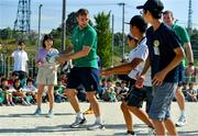 11 October 2019; Jack Carty with students during a visit by the Ireland rugby squad to Kasuga Elementary School in Kusaga, Fukuoka, Japan. Photo by Brendan Moran/Sportsfile