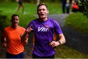 12 October 2019; Vhi ambassador and Olympian David Gillick pictured at the Monaghan Town parkrun, Rossmore Forest Park, Gortnakeegan, Monaghan, where Vhi hosted a special event to celebrate their partnership with parkrun Ireland. Vhi ambassador and Olympian David Gillick was on hand to lead the warm up for parkrun participants before completing the 5km free event. Parkrunners enjoyed refreshments post event at the Vhi Rehydrate, Relax, Refuel and Reward areas. parkrun in partnership with Vhi support local communities in organising free, weekly, timed 5k runs every Saturday at 9.30am. To register for a parkrun near you visit www.parkrun.ie. Photo by Piaras Ó Mídheach/Sportsfile