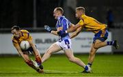 12 October 2019; Darren O'Reilly of Ballyboden in action against Glenn O'Reilly and Jonny Cooper of Na Fianna during the Dublin County Senior Club Football Championship Quarter-Final match between Ballyboden and Na Fianna at Parnell Park in Dublin. Photo by Matt Browne/Sportsfile