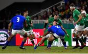 12 October 2019; Jacob Stockdale of Ireland is tackled by Seilala Lam of Samoa, a tackle for which Lam received a yellow card, during the 2019 Rugby World Cup Pool A match between Ireland and Samoa at the Fukuoka Hakatanomori Stadium in Fukuoka, Japan. Photo by Brendan Moran/Sportsfile