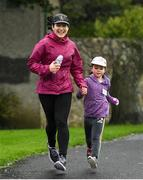 13 October 2019; The Deerpark Junior parkrun where Vhi hosted a special event to celebrate their partnership with parkrun Ireland. Vhi hosted a lively warm up routine which was great fun for children and adults alike. Crossing the finish line was a special experience as children were showered with bubbles and streamers to celebrate their achievement and each child received a gift. Junior parkrun in partnership with Vhi support local communities in organising free, weekly, timed 2km runs every Sunday at 9.30am. To register for a parkrun near you visit www.parkrun.ie.  Photo by Ramsey Cardy/Sportsfile