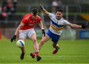 13 October 2019; Richard Donnelly of Trillick in action against Pauric McAnenly of Errigal Ciaran during the Tyrone County Senior Club Football Championship Final match between Errigal Ciaran and Trillick at Healy Park in Omagh, Tyrone. Photo by Oliver McVeigh/Sportsfile