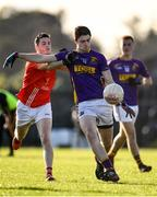 13 October 2019; Kieran Kilcline of Roscommon Gaels in action against Emmet Kelly of Padraig Pearses during the Roscommon County Senior Club Football Championship Final match between Padraig Pearses and Roscommon Gaels at Dr Hyde Park in Roscommon. Photo by Sam Barnes/Sportsfile