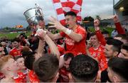 13 October 2019; Michael Gallagher and Trillick players celebrate with the O'Neill Cup after the Tyrone County Senior Club Football Championship Final match between Errigal Ciaran and Trillick at Healy Park in Omagh, Tyrone. Photo by Oliver McVeigh/Sportsfile