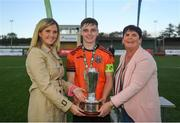 13 October 2019; Sean McManus of Bohemians is presented the Mark Farren Cup by Leanna Sheill of SSE Airtricity and Brigit Flannery, sister of Mark Farren, following the SSE Airtricity League - U17 Mark Farren Cup Final match between Kerry and Bohemians at Mounthawk Park in Tralee, Kerry. Photo by Harry Murphy/Sportsfile