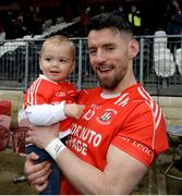 13 October 2019; Mattie Donnelly of Errigal Ciaran celebrates with his two year old nephew Jack Courtney after the Tyrone County Senior Club Football Championship Final match between Errigal Ciaran and Trillick at Healy Park in Omagh, Tyrone. Photo by Oliver McVeigh/Sportsfile