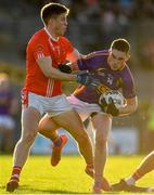 13 October 2019; Richard Hughes of Roscommon Gaels in action against Ronan Daly of Padraig Pearses during the Roscommon County Senior Club Football Championship Final match between Padraig Pearses and Roscommon Gaels at Dr Hyde Park in Roscommon. Photo by Sam Barnes/Sportsfile