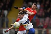 13 October 2019; Michael Gallagher of Trillick in action against Pauric McAnenly of Errigal Ciaran during the Tyrone County Senior Club Football Championship Final match between Errigal Ciaran and Trillick at Healy Park in Omagh, Tyrone. Photo by Oliver McVeigh/Sportsfile