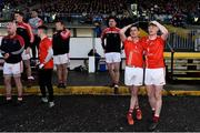 13 October 2019; Emmet Kelly, left, and Paul Carey of Padraig Pearses watch on with team-mates in the final moments of the Roscommon County Senior Club Football Championship Final match between Padraig Pearses and Roscommon Gaels at Dr Hyde Park in Roscommon. Photo by Sam Barnes/Sportsfile