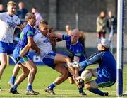 13 October 2019; Dean Healy of St Patrick's in action against Ciaran Hyland, left, James Tyrrell, centre, and Mervyn Travers of Arklow Geraldines Ballymoney during the Wicklow County Senior Club Football Championship Final match between St Patrick's GAA Club and Arklow Geraldines Ballymoney GAA Club at County Grounds in Aughrim, Wicklow. Photo by Garry O'Neill/Sportsfile