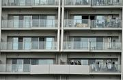 15 October 2019; A resident tends to his washing in an apartment overlooking Ireland Rugby squad training in Arcs Urayasu Park in Urayasu, Aichi, Japan. Photo by Brendan Moran/Sportsfile