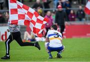 13 October 2019; A dejected Aidan McCrory of Errigal Ciaran as a Trillick supporter runs on to the field after the Tyrone County Senior Club Football Championship Final match between Errigal Ciaran and Trillick at Healy Park in Omagh, Tyrone. Photo by Oliver McVeigh/Sportsfile