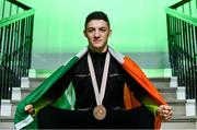 15 October 2019; Rhys McClenaghan of Ireland poses for a portrait with his Bronze medal from the pommel-horse final at the 49th FIG Artistic Gymnastics World Championships during the Gymnastics Ireland Homecoming Press Conference at Ely Place in Dublin. Photo by Sam Barnes/Sportsfile