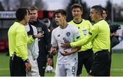 15 October 2019; Jayson Molumby of Republic of Ireland is restrained by assistant referee Vasili Ermischin, right, from speaking to referee Dumitri Muntean following the UEFA European U21 Championship Qualifier Group 1 match between Iceland and Republic of Ireland at Víkingsvöllur in Reykjavik, Iceland. Photo by Eythor Arnason/Sportsfile