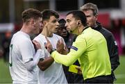 15 October 2019; Kameron Ledwidge, left, and Jayson Molumby of Republic of Ireland, with head coach Stephen Kenny, right, remonstrate to referee Dumitri Muntean following the UEFA European U21 Championship Qualifier Group 1 match between Iceland and Republic of Ireland at Víkingsvöllur in Reykjavik, Iceland. Photo by Eythor Arnason/Sportsfile