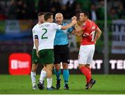 15 October 2019; Referee Szymon Marciniak attempts to separate Seamus Coleman of Republic of Ireland and Granit Xhaka of Switzerland during the UEFA EURO2020 Qualifier match between Switzerland and Republic of Ireland at Stade de Genève in Geneva, Switzerland. Photo by Seb Daly/Sportsfile