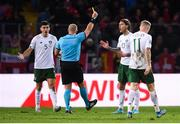 15 October 2019; Jeff Hendrick of Republic of Ireland receives a yellow card from referee Szymon Marciniak during the UEFA EURO2020 Qualifier match between Switzerland and Republic of Ireland at Stade de Genève in Geneva, Switzerland. Photo by Stephen McCarthy/Sportsfile