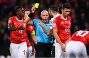 15 October 2019; Shane Duffy of Republic of Ireland receives a yellow card from referee Szymon Marciniak during the UEFA EURO2020 Qualifier match between Switzerland and Republic of Ireland at Stade de Genève in Geneva, Switzerland. Photo by Stephen McCarthy/Sportsfile