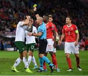 15 October 2019; Shane Duffy of Republic of Ireland remonstrates with referee Szymon Marciniak after being shown a yellow card during the UEFA EURO2020 Qualifier match between Switzerland and Republic of Ireland at Stade de Genève in Geneva, Switzerland. Photo by Seb Daly/Sportsfile