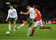15 October 2019; John Egan of Republic of Ireland takes a shot under pressure from Stephan Lichtsteiner of Switzerland during the UEFA EURO2020 Qualifier match between Switzerland and Republic of Ireland at Stade de Genève in Geneva, Switzerland. Photo by Seb Daly/Sportsfile