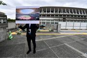 16 October 2019; A member of the Tokyo 2020 organising Committee staff holds up artists impressions of the finished Tokyo Olympic Stadium, Tokyo 2020 Summer Olympic Games venue for the opening and closing ceremonies, football and athletics, during the Tokyo 2nd World Press Briefing venue tour ahead of the 2020 Tokyo Summer Olympic Games. The Tokyo 2020 Games of the XXXII Olympiad take place from Friday 24th July to Sunday 9th August 2020 in Tokyo, Japan, the second Summer Olympics Games to be held in Tokyo, the first being 1964. Photo by Brendan Moran/Sportsfile