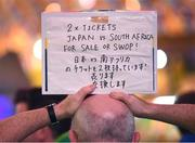 18 October 2019; A supporter selling match tickets in Tokyo ahead of the 2019 Rugby World Cup Quarter-Final match between Ireland and New Zealand. Photo by Ramsey Cardy/Sportsfile