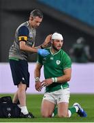 19 October 2019; Robbie Henshaw of Ireland receives medical attention from Ireland team physio Keith Fox during the 2019 Rugby World Cup Quarter-Final match between New Zealand and Ireland at the Tokyo Stadium in Chofu, Japan. Photo by Brendan Moran/Sportsfile