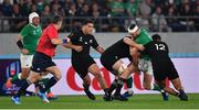 19 October 2019; Robbie Henshaw of Ireland loses possession in a tackle by Sam Cane and Anton Lienert-Brown of New Zealand during the 2019 Rugby World Cup Quarter-Final match between New Zealand and Ireland at the Tokyo Stadium in Chofu, Japan. Photo by Brendan Moran/Sportsfile