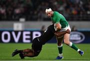 19 October 2019; Robbie Henshaw of Ireland is tackled by Sevu Reece of New Zealand during the 2019 Rugby World Cup Quarter-Final match between New Zealand and Ireland at the Tokyo Stadium in Chofu, Japan. Photo by Brendan Moran/Sportsfile