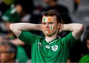 19 October 2019; A dejected Ireland supporter during the 2019 Rugby World Cup Quarter-Final match between New Zealand and Ireland at the Tokyo Stadium in Chofu, Japan. Photo by Ramsey Cardy/Sportsfile
