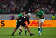 19 October 2019; Jonathan Sexton of Ireland is tackled by Sevu Reece of New Zealand as he attempts to pass to team-mate Rob Kearney during the 2019 Rugby World Cup Quarter-Final match between New Zealand and Ireland at the Tokyo Stadium in Chofu, Japan. Photo by Brendan Moran/Sportsfile