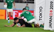 19 October 2019; Codie Taylor of New Zealand scores his side's fourth try despite the tackle of Conor Murray of Ireland during the 2019 Rugby World Cup Quarter-Final match between New Zealand and Ireland at the Tokyo Stadium in Chofu, Japan. Photo by Brendan Moran/Sportsfile