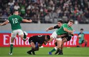 19 October 2019; Jordan Larmour of Ireland is tackled by Richie Mo'unga and Anton Lienert-Brown of New Zealand during the 2019 Rugby World Cup Quarter-Final match between New Zealand and Ireland at the Tokyo Stadium in Chofu, Japan. Photo by Brendan Moran/Sportsfile