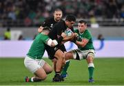 19 October 2019; Anton Lienert-Brown of New Zealand is tackled by Andrew Porter, left, and CJ Stander of Ireland during the 2019 Rugby World Cup Quarter-Final match between New Zealand and Ireland at the Tokyo Stadium in Chofu, Japan. Photo by Brendan Moran/Sportsfile
