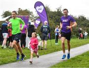 19 October 2019; Julie Powers, age 5, from Carpenterstown, Dublin, is pictured running alongside Vhi ambassador and Olympian David Gillick at the Porterstown parkrun where Vhi hosted a special event to celebrate their partnership with parkrun Ireland. David was on hand to lead the warm up for parkrun participants before completing the 5km free event. Parkrunners enjoyed refreshments post event at the Vhi Rehydrate, Relax, Refuel and Reward areas. parkrun in partnership with Vhi support local communities in organising free, weekly, timed 5k runs every Saturday at 9.30am. To register for a parkrun near you visit www.parkrun.ie. Photo by Seb Daly/Sportsfile