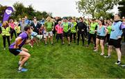 19 October 2019; Vhi ambassador and Olympian David Gillick leads the warm-up at the Porterstown parkrun where Vhi hosted a special event to celebrate their partnership with parkrun Ireland. Parkrunners enjoyed refreshments post event at the Vhi Rehydrate, Relax, Refuel and Reward areas. parkrun in partnership with Vhi support local communities in organising free, weekly, timed 5k runs every Saturday at 9.30am. To register for a parkrun near you visit www.parkrun.ie. Photo by Seb Daly/Sportsfile