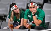 19 October 2019; Dejected Ireland supporters after the 2019 Rugby World Cup Quarter-Final match between New Zealand and Ireland at the Tokyo Stadium in Chofu, Japan. Photo by Brendan Moran/Sportsfile